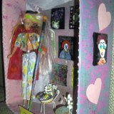 Shadow box of Barbie with paintbrush and paintings