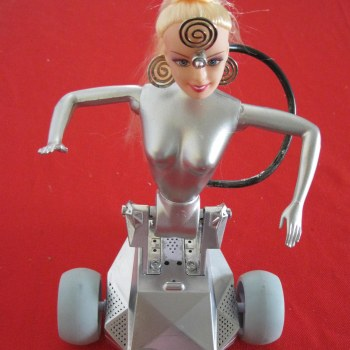 This is a voice activated Barbie Robot; dances, moves, lights up, and noisy